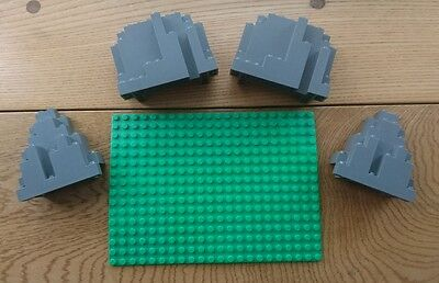 Lego rock pieces and green base plate