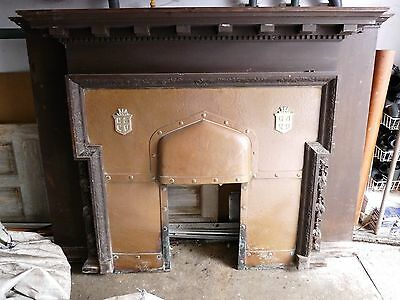 Antique Arts and Crafts hardwood fireplace with beaten copper insert