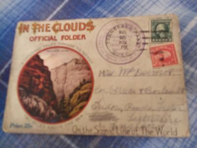 In The Clouds official folder card