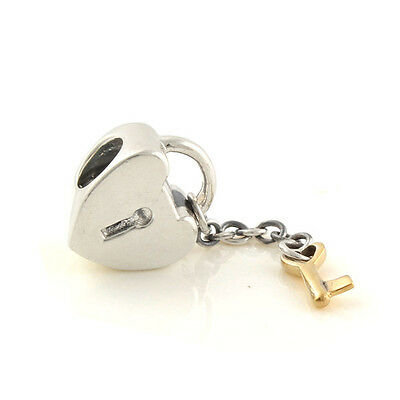 Genuine PANDORA sterling silver and 14ct Gold Heart Lock & Key Charm 790288