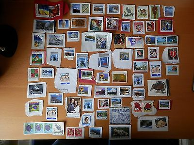 Joblot Of 75 Used Stamps On Paper From New Zealand.