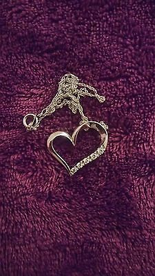 0.15 CT. T.W. Diamond Five Stone Heart Pendant (worn once) in 10K White Gold