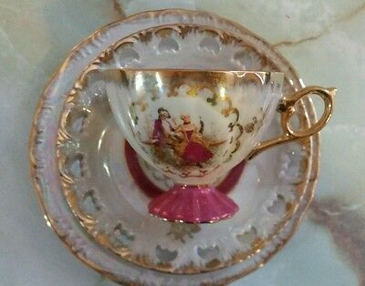 Enchanting pink and gold vintage/antique tea cup trio