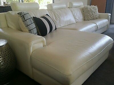 White leather 3 seater plus chaise lounge from Domayne