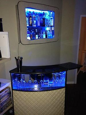 retro cocktail bar with wall mount and bar stool