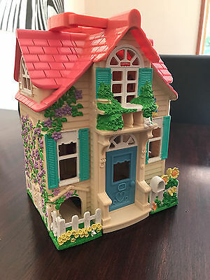 Children's Fisher Price Family Pink Take Along Dolls House