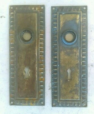 Two old brass door back plates