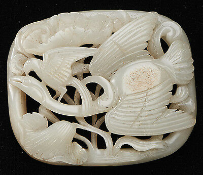 A Chinese White And Russet Jade Egret And Lotus Ornament
