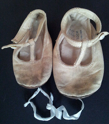 Antique childrens shoes in leather with ribbon