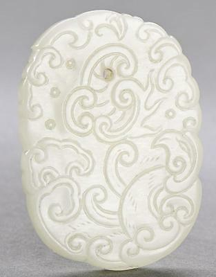 A Chinese White Jade Dragon Pendant