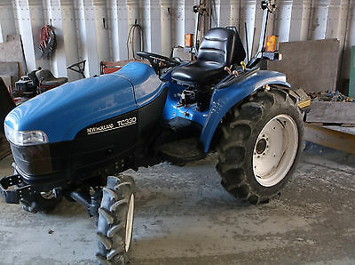 New Holland 330 tractor 4 x 4
