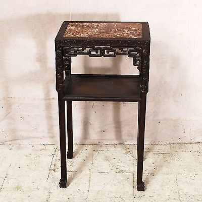 19th century Chinese marble top stand in dense hardwood with detailed carving