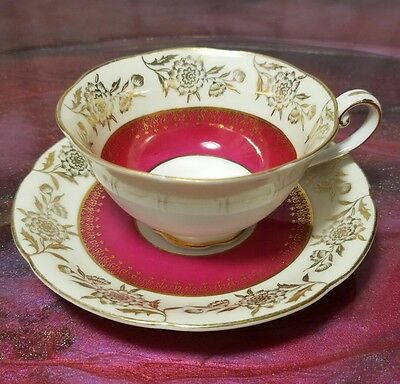 Tokyo China Tea Cup And Saucer , Red with Gold Gilding Roses