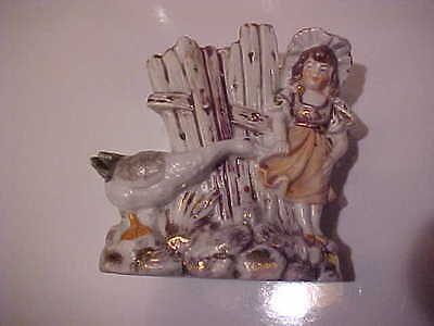 Antique bisque girl and goose match holder