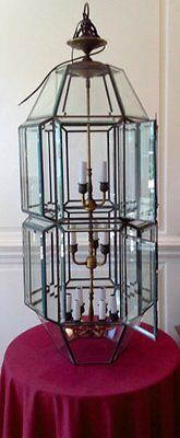 Old Four Tiered Beveled Glass Brass Hanging Fixture With Twelve lights.