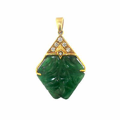 Carved emerald pendent set in 18Ct gold with diamonds(1302)