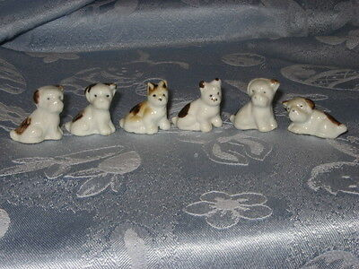 "vintage bone china dogs, lot of 6, Japan, 1 1/2"" tall, white with brown spots"