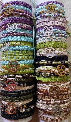 Wholesale set of  60 adjustable 12 x S/5 friendship  bracelets with ohm charm