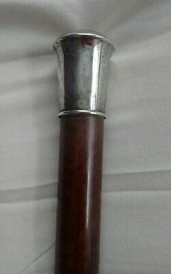 Antique silver topped wooden walking stick/cane, tortoise shell type wood.