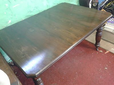 Antique Victorian walnut wind out dinning table with extra leaf