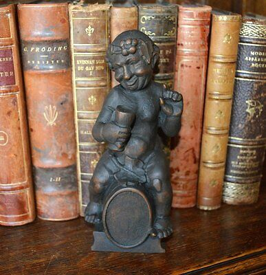 Antique Black Forest Carved Wood Bacchus Figure on a Wine Barrel