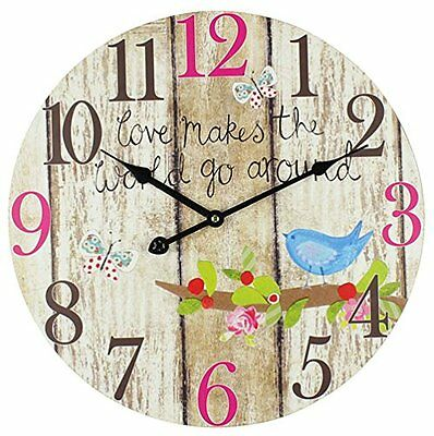 "Home Living "" What Makes The World Go Round Clock """