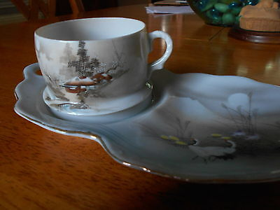 Beautifully painted Japanese Eggshell Cup and Saucer