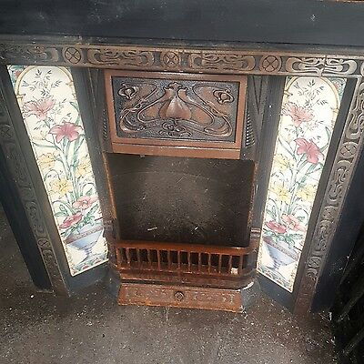 reproduction cast iron tiled fireplace