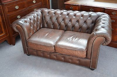 Brown leather two seat chesterfield sofa