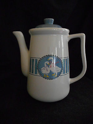 White & blue ceramic tea pot with ducks/geese
