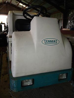 "Tennant 7200 floor scrubber. 36""wide, 2475 hours, with batteries and charger"