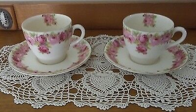 Two Royal Doultan Raby Rose Tea cup duos.