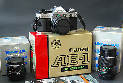 Vintage Working Canon Ae-1 Program 35Mm Camera Extra Lenses Case Box Manuals