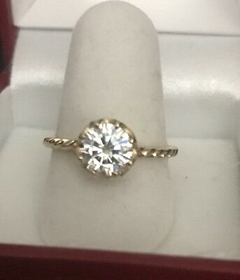 14K yellow gold solitaire ring set with 1.5 carat moissanite