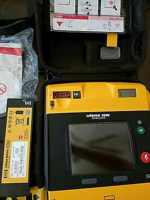 Lifepak 1000, with battery, pads, and case, free shipping in the U.S.