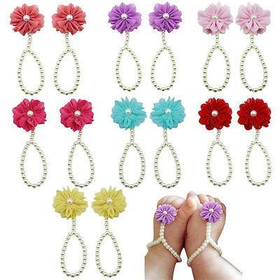 Beautiful sky blue baby foot blooms to complete baby's summer outfit.