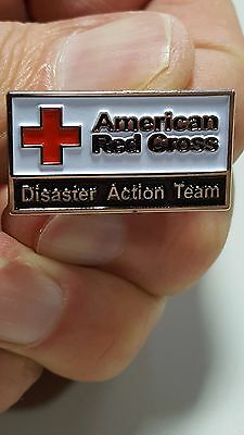 """2009, """"DISASTER ACTION TEAM"""" pin for the American Red Cross"""