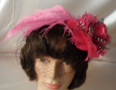Lovely New Fascinator with pink and black trim black netting