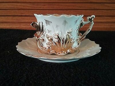 Gold and White Antique Teacup and Saucer