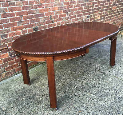 A Superb Antique Solid Mahogany Wind Out Extending Dining Table.