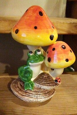 Ceramic Frog figurine hugging a Mushroom Porch Garden Decor yellow orange