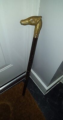 Vintage Walking Stick (missing the bottom part)with brass horses head handle. .