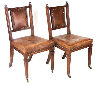 A pair of Victorian Oak & Leather Dining Chairs by GILLOWS & CO [PL3491]