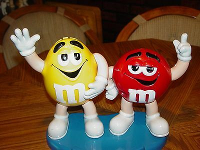 M & M Candy Dispenser - Two Characters Red & Yellow