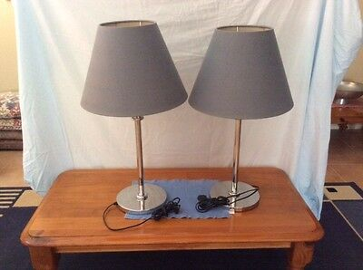 table lamps - pair used, stainless steel  base and stand, material shades