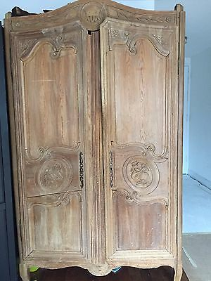 A French XVI Style Carved Pine Armoire