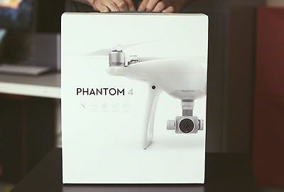 PHANTOM 4 DJI with12  Warranty  new in Box , EXTRA BATTERY