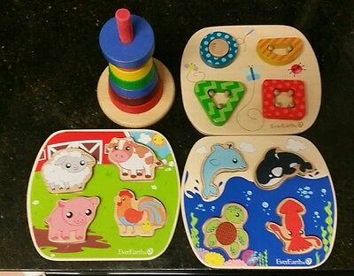 Baby wooden puzzles x 4 sets.  baby activity toys.