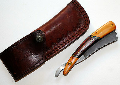 Beautiful cut throat straight razor with wooden handle and leather pouch