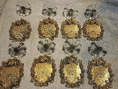 8 vintage 18 kt gold florenta backplates and knob. 4 from 1968, and 4 from 1970.